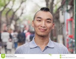 young man with mohawk haircut smiling looking at camera stock