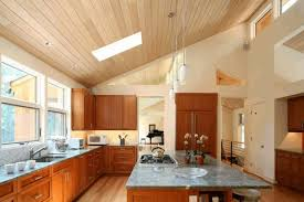 vaulted ceiling in kitchen rectangle brown gloss kitchen table two