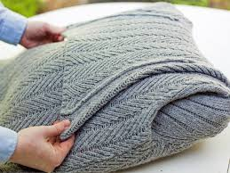 how does it take to knit a sweater turn an sweater into a chic preppy pillow hgtv