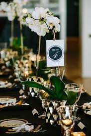 orchid centerpieces black white and gold tablescape with orchid centerpieces wedding