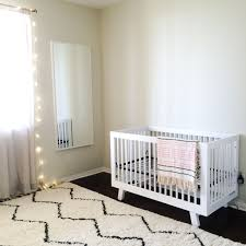exquisite rustic baby crib and white fur rug on the brow carpet