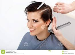hairdresser doing hairstyle brunette with short hair in hair sa