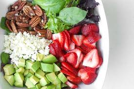 strawberry avocado salad with poppy seed dressing ahead of thyme