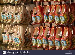 row of clogs sabot or dutch wooden shoes painted with windmill and