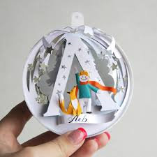 i cut personalized paper ornaments for my friends this