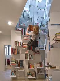 bookcase in a stairwell that you access via bosun u0027s chair boing