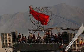 Burning Red Flag Burning Man Fire And Dust Draw 70 000 People To Nevada Desert