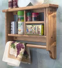 lacquer brown wooden towel shelf with rod and beadboard pattern