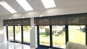 electric roller blinds for byfold doors hidden behind a pelmet