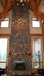 modern corner fireplace design with white cobblestone wood cool
