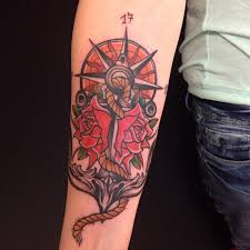 flowers and anchor on right forearm