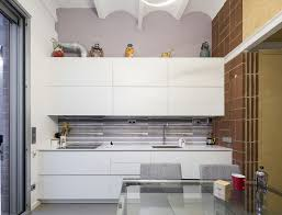 modern kitchen in old house old blacksmith workshop in barcelona transformed into a light