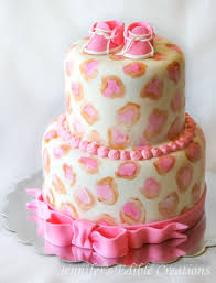 leopard print baby shower cake with edible baby shoes cake by
