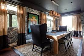 this eclectic room works as a dining room or a game room with a
