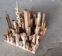 micro metros abstract city models carved from wooden scraps