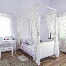 splendent minimalist four post bed together with silver tea and