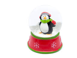 photo of cute little penguin in a snow globe free christmas images