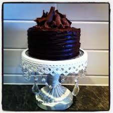 two tier white chocolate mud cake decorated with white chocolate