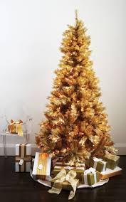 skinny green artificial pine tree decor with blue and golden