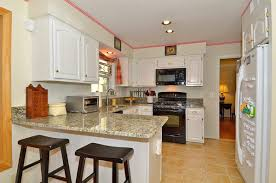 Modern Kitchen With White Appliances White Living Room Kitchen Design White Cabinets White Appliances