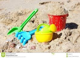 children u0027s beach toys bucket spade and shovel on sand on a