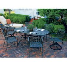 oval aluminum patio table windham woven 94 oval umbrella dining table with scroll base wo709414
