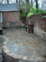 Outdoor Slate Patio Outdoor Living Backyard Design With Brick Wall And Natural