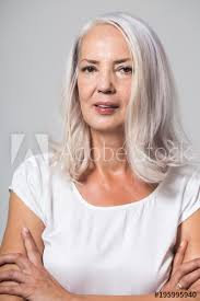 old hair at 59 attractive youthful fifty year old woman with shoulder length grey
