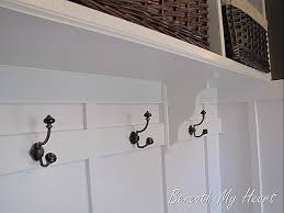Laundry Room Hangers - re hanging the hooks in our laundry room and it looks a ton