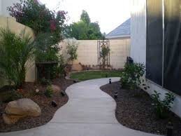 Arizona Backyard Ideas by Curvy Sidewalk With Mounding And Plants Dress Up A Boring Side