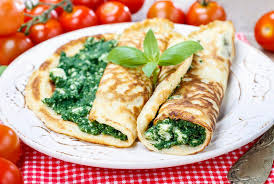 cuisine crepe mediterranean cuisine crepes stuffed with cheese and spinach stock