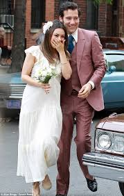 mila kunis slips on a seventies style wedding dress to marry on