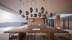 dining room designed with moroccan style pendants over large