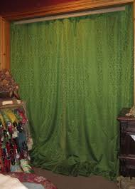 a pair of 19th century green silk damask curtains c 1880 to 1900