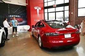 tesla tesla still on top in us electric vehicle sales gm close behind
