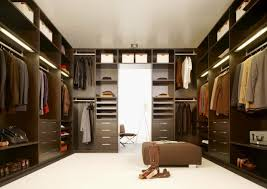 modern walk in dressing room design with black shelves cabinet and