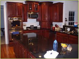 Kitchen Cabinets Granite Countertops by Black Granite Countertops Cherry Cabinets Kitchen Quote Yellow