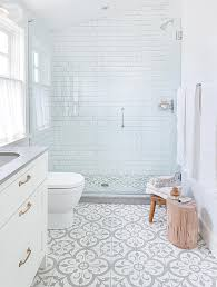 grey and white cement floor tiles provide ornate pattern in the