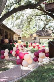 blush and marsala balloons lining a walkway for a party or a