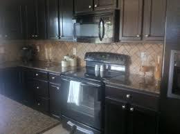 herringbone kitchen backsplash ideas u0026 tips herringbone backsplash with dark wood cabinets and
