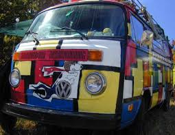 snoopy s vw with the partridge family paint scheme driving