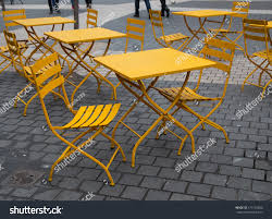 yellow metal cafe table chairs outdoors stock photo 177793280