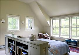 bookcase headboard in bedroom farmhouse with table behind couch