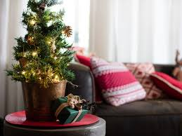 lovely small tree accessory on tiny end table front chocolate sofa