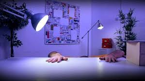 Under Desk Lighting Funny Character Working Late At The Office Under A Desk Lamp Puts