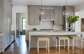 brushed brass cabinet pulls gray kitchen island with gold counter stools transitional kitchen
