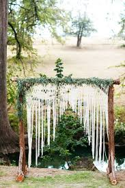 wedding arch log picture of a rustic log arch with crochet lace and greenery for a