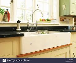 Kitchen Sink Fitting Water Running From Tap Fitting Into Kitchen Sink Unit Beneath