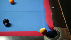 Felt Pool Table by Game Of Pool With Blue Felt Pool Table Sinking Black In Corner