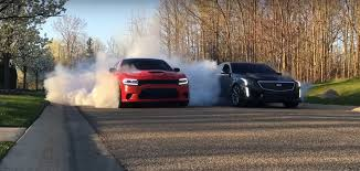 charger hellcat burnout charger hellcat fights cadillac cts v on winter tires in brutal